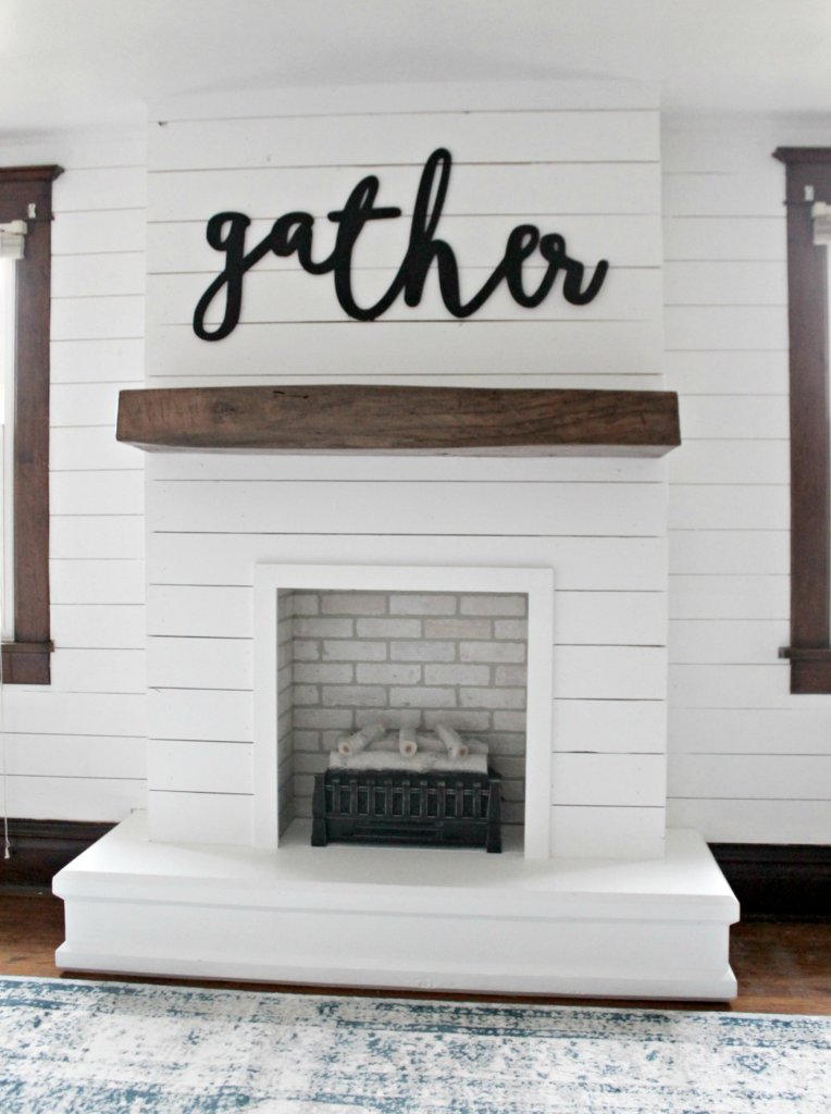 Diy shiplap fireplace the definery co for Diy fireplace wall ideas